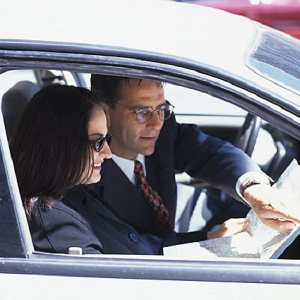 business man and woman in car