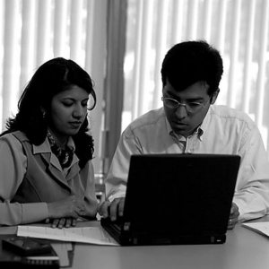 business man and woman looking at laptop