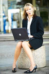 Commercial realtor businesswoman using a laptop computer