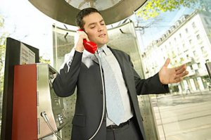 business man on a pay phone
