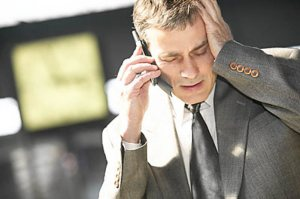 businessman talking on mobile phone outside