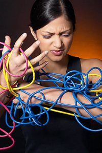 woman wrestling with cables