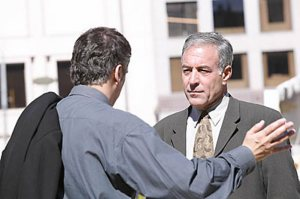 two business men talking in the street