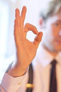 Commercial Real Estate Agent giving Ok handsign