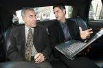two commercial real estate agents talking in car