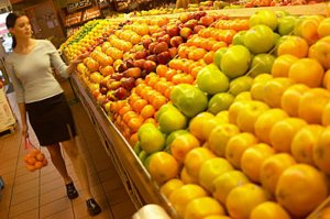 woman walking in fruit store