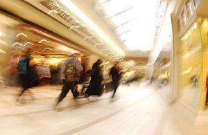 people walking through a retail shopping centre