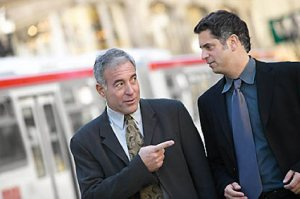 two business men talking in street