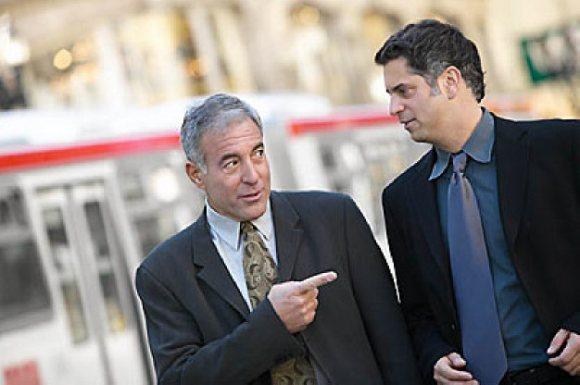 two business men talking in street