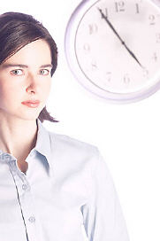 woman standing in front of clock