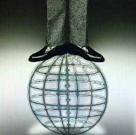 man standing on image of world globe.