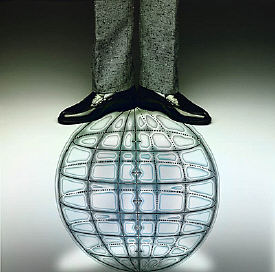 man standing on image of world globe.