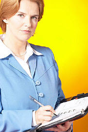 business woman writing in book