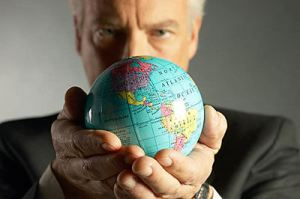 man holding globe