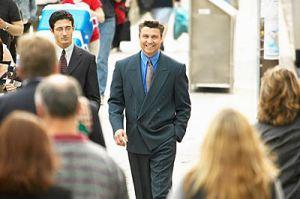 two business men walking in city street.
