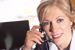 woman talking on headset telephone