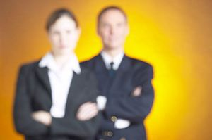 two business people standing in blur