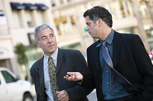 business men walking in street and talking
