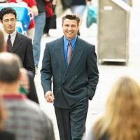 two business men walking in street.
