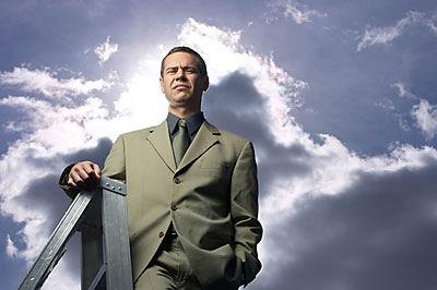Business man climbing ladder uid 1342822