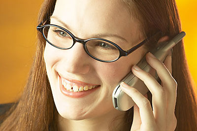 Smiling businesswoman talking on cell phone uid 1173570