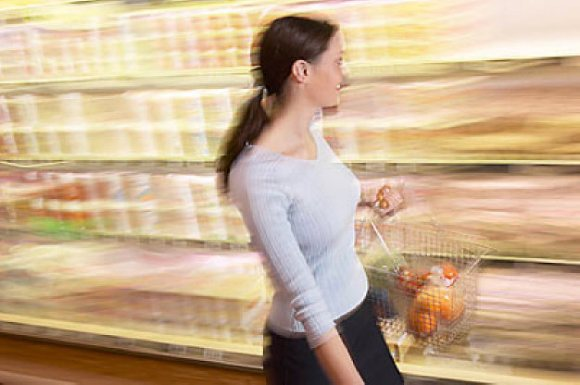 Woman grocery shopping in a blur uid 1344027