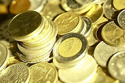 Pile of international coins uid 1177794