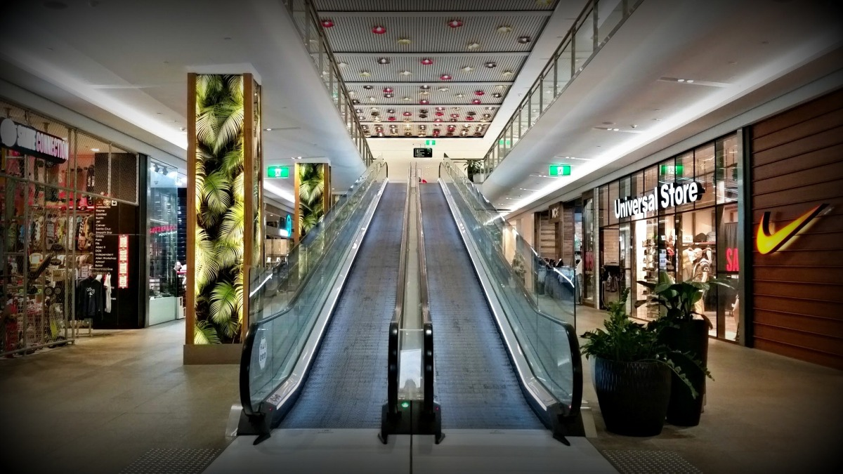 shopping center escalator in mall