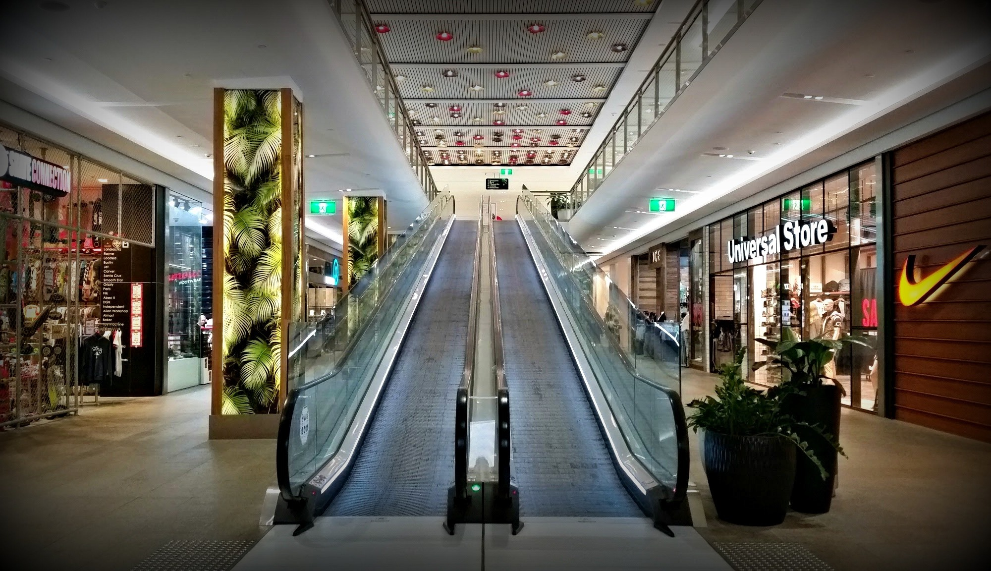 shopping center escalator in mall