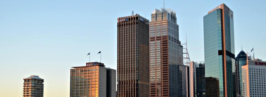 city buildings against blue skyline